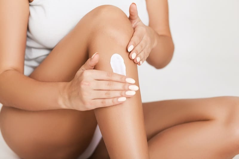 woman with flaky dry skin on leg