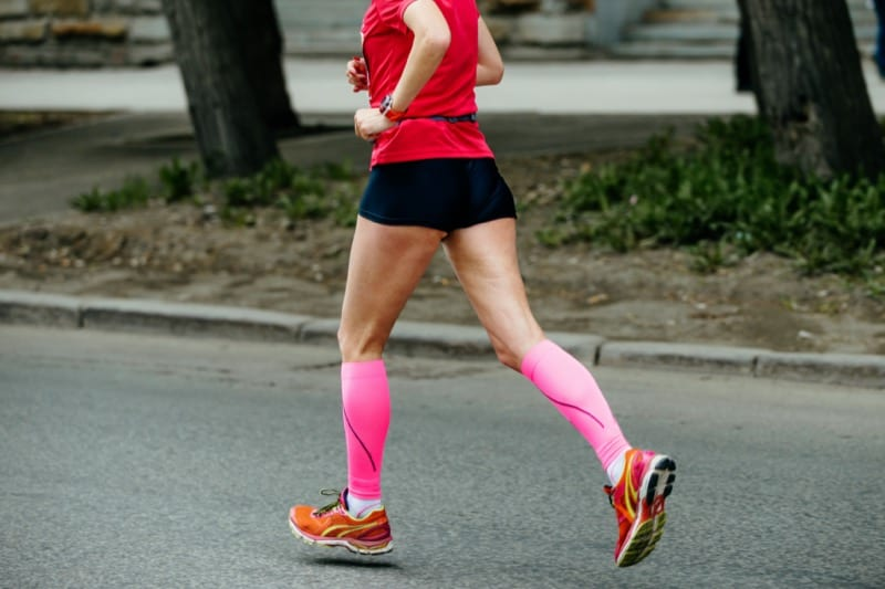 woman with poor blood circulation wearing compression socks
